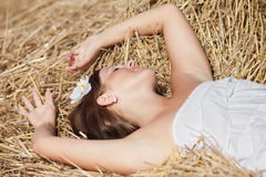 Girl sleeping on a hayloft Stock Photography