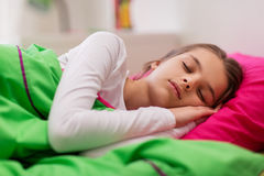 Girl sleeping in her bed at home Royalty Free Stock Images