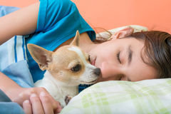 Girl sleeping with her dog Royalty Free Stock Photography