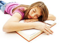 Girl Sleeping with Her Head on an Open Book Stock Image