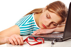 Girl sleeping on her laptop Stock Images