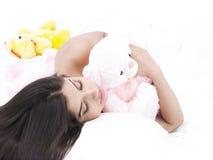 Girl sleeping with her teddy bear Stock Photo