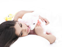 Girl sleeping with her teddy bear Royalty Free Stock Image