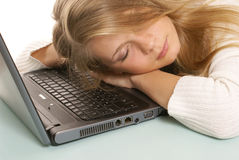 Girl sleeping on the laptop Royalty Free Stock Photo