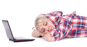 Girl sleeping with laptop Royalty Free Stock Photo