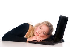 Girl sleeping with laptop Royalty Free Stock Photos