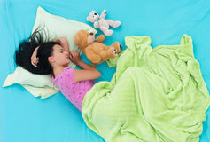 Girl sleeping like a child stock photos