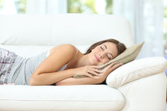 Girl sleeping or napping happy on a couch Stock Photo