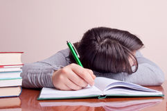 Girl sleeping on the notebook Stock Photography