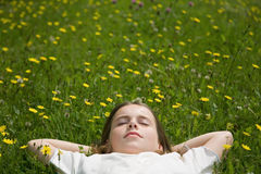 Girl sleeping outside Royalty Free Stock Images