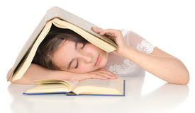 Girl sleeping over the book. Royalty Free Stock Image