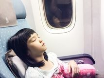 Girl sleeping in the plane Stock Photography
