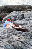Girl sleeping at reef Stock Photography