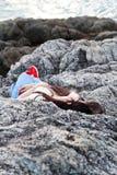 Girl sleeping at reef Stock Photography