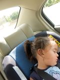 Girl sleeping in safety seat Stock Image