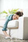Girl sleeping on sofa Royalty Free Stock Image