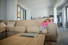 Girl sleeping on sofa in the living room. At home Stock Image