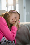 Girl sleeping on sofa in the living room Royalty Free Stock Image