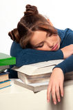Girl sleeping on a stack of books Stock Photos