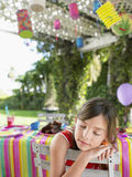 Girl Sleeping At Table After Birthday Party. Closeup of a little young girl sleeping at table after birthday party Stock Images