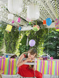 Girl Sleeping At Table After Birthday Party. Young little girl sleeping at table after birthday party Stock Images