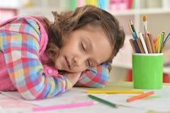 Girl sleeping at  table. Cute girl sleeping at  table  at home Royalty Free Stock Images