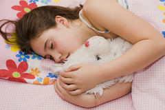 Girl sleeping with teddy bear. A young girl sleeping holding a teddy bear Royalty Free Stock Photo
