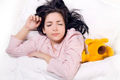 Girl sleeping with teddy bear Royalty Free Stock Photography