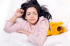 Girl sleeping with teddy bear royalty free stock photography