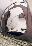 Girl sleeping in a tent Royalty Free Stock Photography