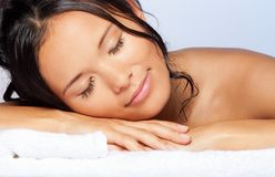 Girl sleeping on the towel Royalty Free Stock Image