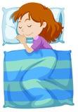 Girl sleeping under blanket Stock Image