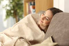 Girl sleeping warmly on a comfortable couch Stock Photography