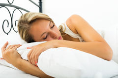 Girl sleeping with white pillow Stock Images