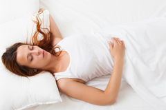 Girl sleeping on a white pillow in bed at home Stock Photography