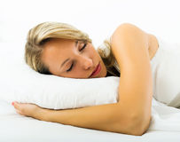 Girl sleeping with white pillow in bed Royalty Free Stock Image