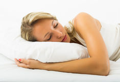 Girl sleeping on white pillow Royalty Free Stock Photo
