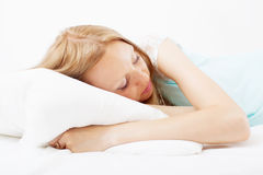Girl  sleeping on white pillow Stock Photos