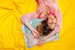 Girl sleeping on the yellow sheet Royalty Free Stock Photography