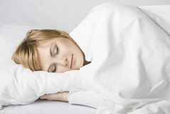 Girl sleeps in bed Stock Photos