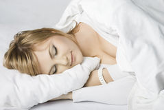 Girl sleeps in bed Royalty Free Stock Image
