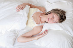 Girl sleeps in a bed Royalty Free Stock Photography