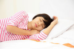 Girl sleeps in the bedroom Royalty Free Stock Images
