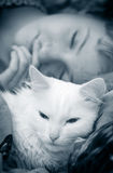 Girl sleeps with cat royalty free stock photography