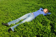 The girl sleeps in a grass Royalty Free Stock Photos