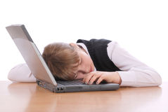 Girl sleeps having put a head on laptop Royalty Free Stock Photography