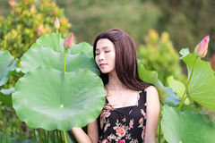 A girl sleeps on the lotus leaf Stock Photo