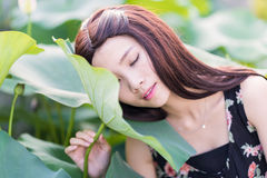 A girl sleeps on the lotus leaf Royalty Free Stock Images