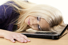 Girl Sleeps On A Laptop Royalty Free Stock Images