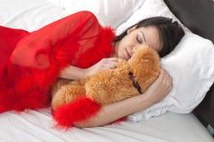 Girl sleeps with teddy bear Stock Photos